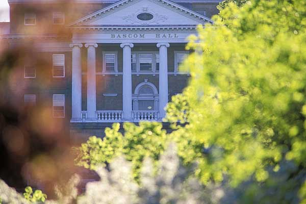 Telephoto lens view of Bascom Hall, viewed through the trees on Library Mall during an late afternoon in spring.